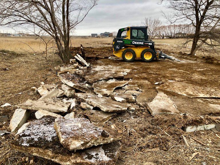 Winnipeg Bin & Dumpster Rentals by WinBins - skid steer concrete pad copy small
