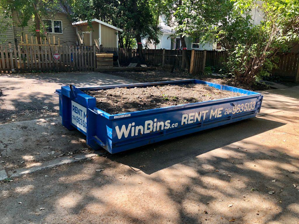 Winnipeg Bin & Dumpster Rentals by WinBins - 4 yard winbin loaded nicely with mud